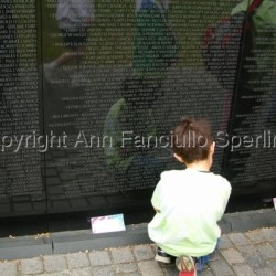 Child at Vietnam Memorial by Ann Fanciullo Sperling